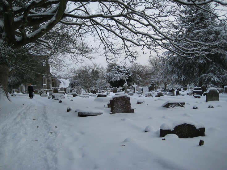 Banstead All Saints graveyard after snowfall