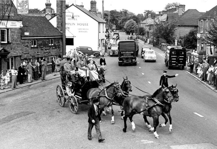 Stagecoach arrives at the Red Lion, Handcross