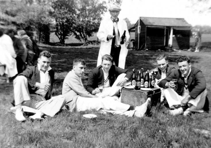 Pease Pottage cricketers enjoying a tea break