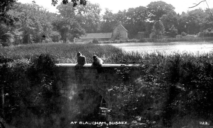 Mill Pond at Slaugham with two men on the bridge