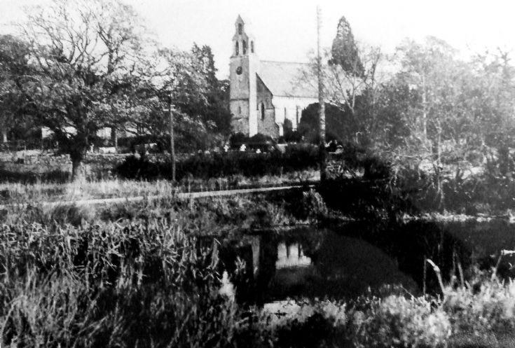Staplefield church viewed across the pond