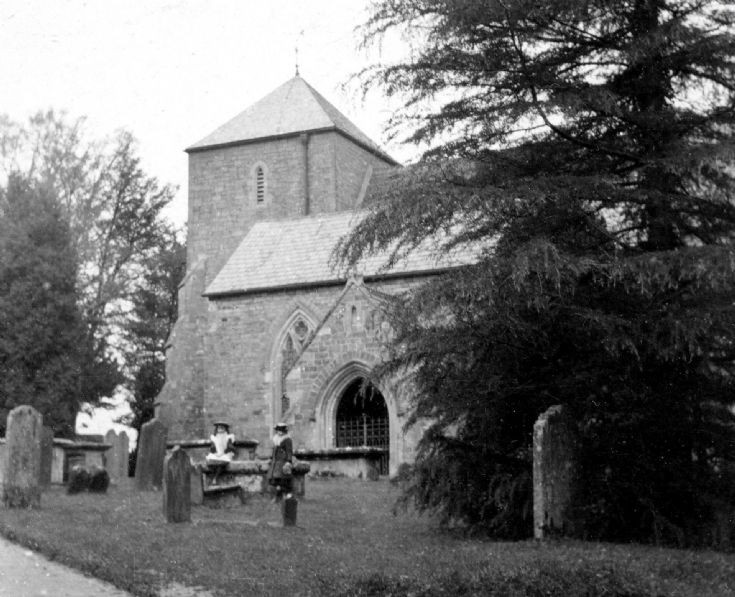 Slaugham church with two girls in churchyard