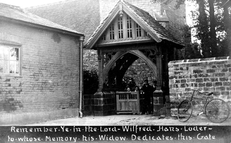 Children standing under the lych gate at Slaugham