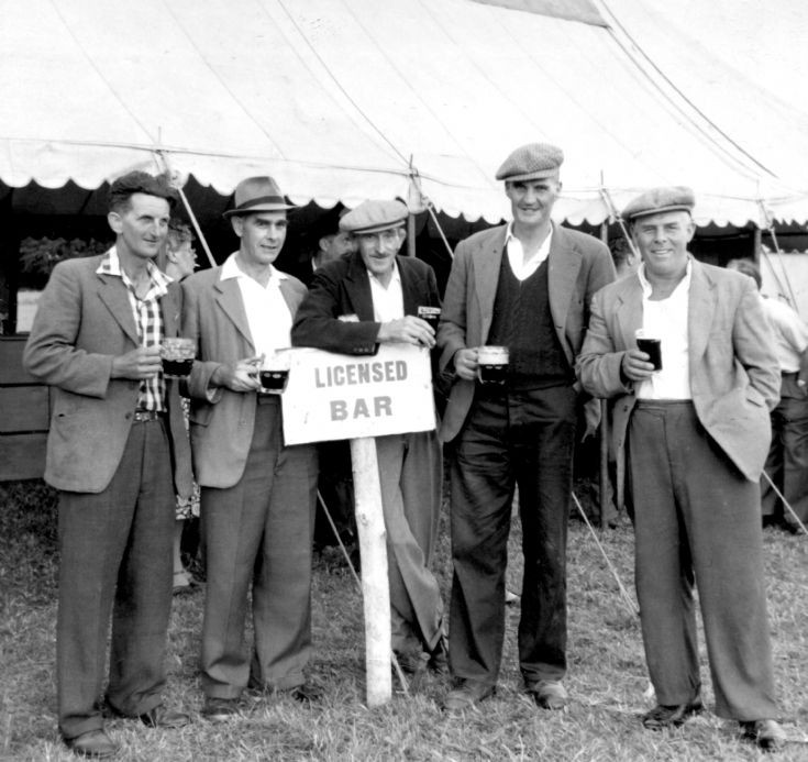Handcross men outside the beer tent