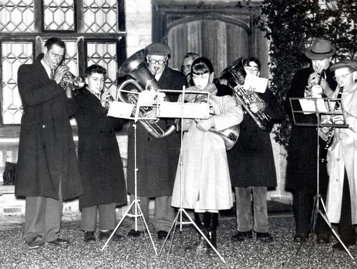 Handcross band playing carols