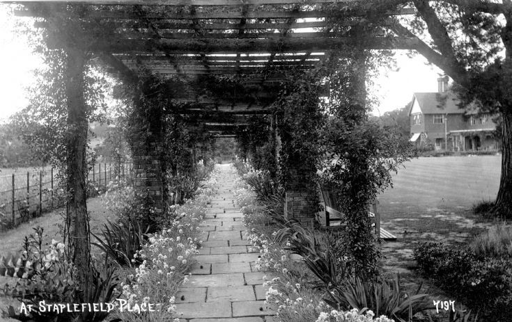 A pergola at Staplefield Place
