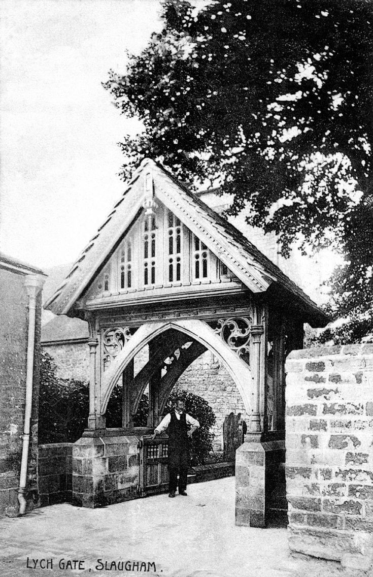 The verger beneath the lych gate at Slaugham