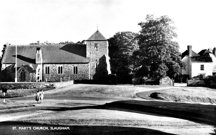 Slaugham church with ladies passing by