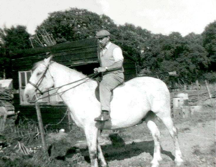 Tom Kinnard riding white horse