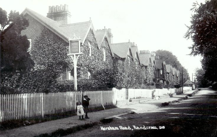 Two children outside Warren Cottages, Handcross