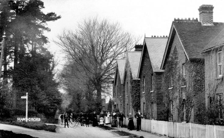 A gathering outside Highbury Cottages, Handcross