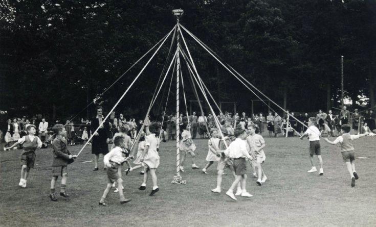 Maypole dancing in Handcross recreation ground